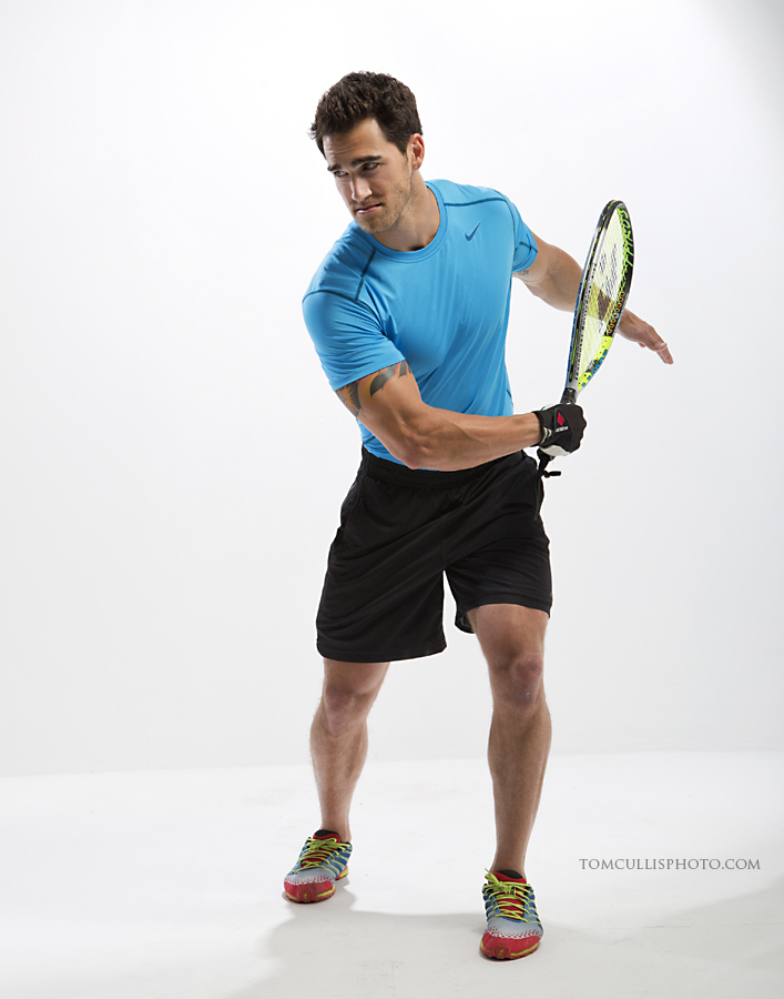 Rocky Russo, model and trainer, posing with tennis racket